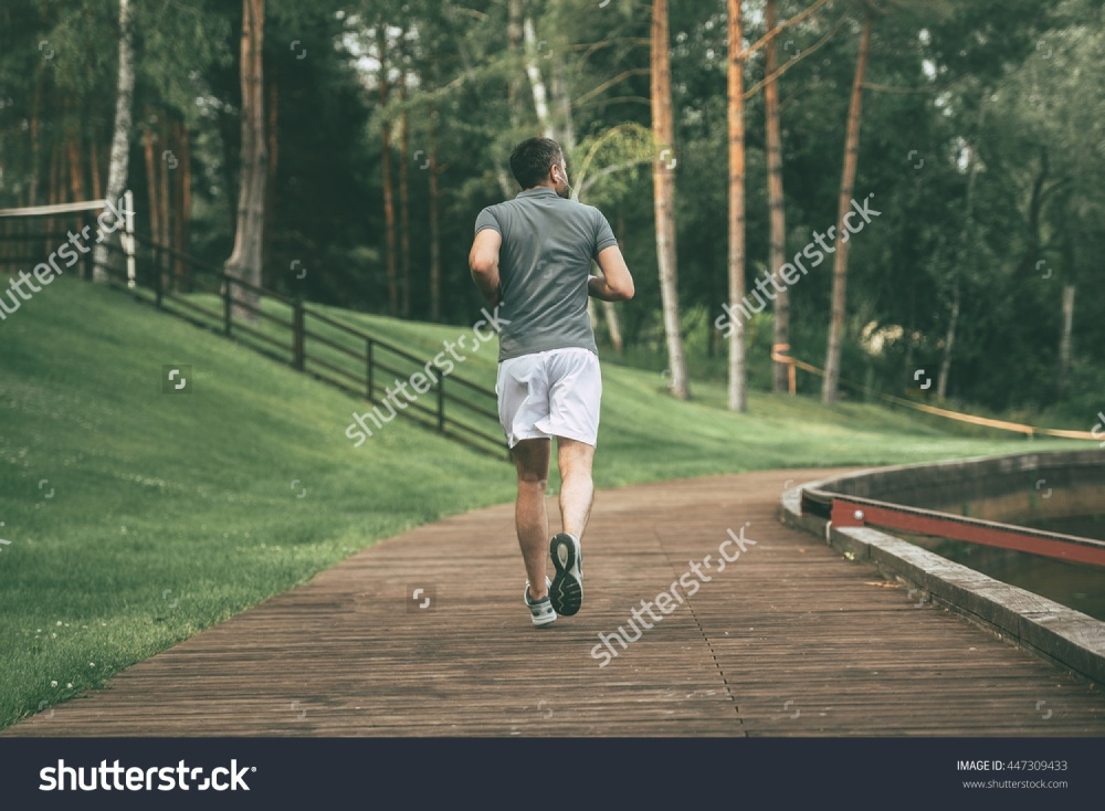 stock-photo-starting-day-from-morning-jog-full-length-rear-view-of-young-man-in-sports-clothing-jogging-in-447309433